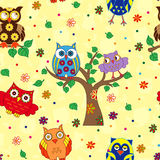 Colourful owl and tree seamless pattern over yellow Stock Image