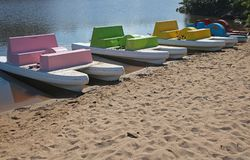 Colourful paddle boats at Ramsgate lagoon. Colourful paddle boats at Ramsgate lagoon with dry sand in the foreground Stock Photo