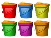 Colourful pails with sands Royalty Free Stock Images