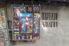 Colourful painting suspended from clay made wall in Pingla village. Stock Photos