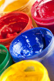 Colourful paints and paintbrushes Stock Photos