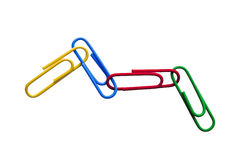 Colourful Paper clips. Four colourful paper clips joined together making patten Stock Images