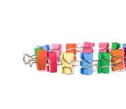 Colourful paper clips arranged into circle. Stock Photos
