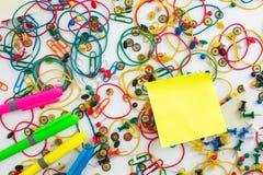 Colourful paper clips, drawing pins thumb tacks, elastic rubber Stock Image