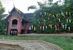 Colourful paper lantern hanging on tree in the temple. Wat Pun Tao temple , Chiangmai , Thailand . Traditional silk lanterns light up the city in the evening and stock images