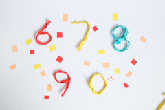 Colourful paper number on white background (6 7 8 9 0). Wire wrapped by colourful paper to number on white background with decoration (6 7 8 9 0 Stock Photos
