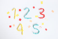 Colourful paper number on white background (1 2 3 4 5). Wire wrapped by colourful paper to number on white background with decoration (1 2 3 4 5 Royalty Free Stock Photo