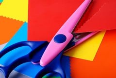 Colourful paper and scissors. Many colourful paper, cutting out scissors Royalty Free Stock Photo