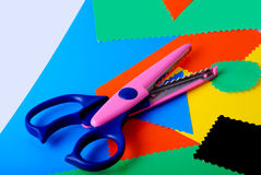 Colourful paper and scissors. Many colourful paper, cutting out scissors Stock Photo
