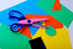 Colourful paper and scissors. Many colourful paper, cutting out scissors Royalty Free Stock Images