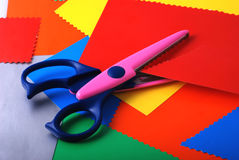 Colourful paper and scissors stock photos