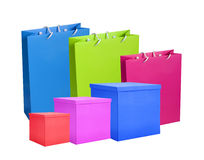 Colourful paper shopping bags and boxes isolated Stock Images
