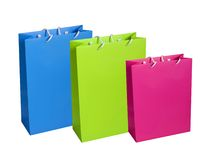 Colourful paper shopping bags isolated on white Stock Images