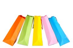 Hand holding multicolored paper bags isolated on white, shopping concept stock photo
