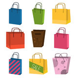 Colourful paper shopping bags isolated on white vector set. Royalty Free Stock Image