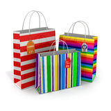 Colourful paper striped shopping bags  on white backgrou Royalty Free Stock Image