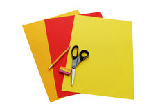 Colourful papers, scissors, pencil and eraser Stock Photos