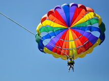 Colourful parasail in clear blue sky Stock Photography