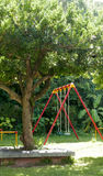 Colourful park swings Royalty Free Stock Images