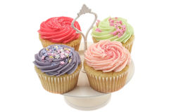 Colourful party cupcakes on a cake stand Royalty Free Stock Image