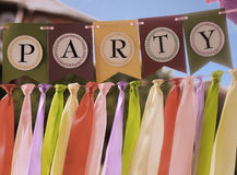 Colourful party swag banner. Colourful festive swag banner with ribbons for party decoration Stock Images