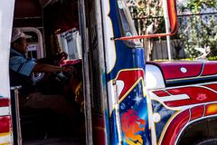 Colourful passenger busses making their way around Cochabamba, Bolivia. Royalty Free Stock Image