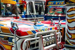 Colourful passenger busses making their way around Cochabamba, Bolivia. Stock Photo