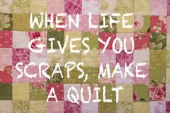 Colourful patchwork quilt with positive inspiring quote stock images