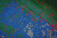 Colourful pattern on a metal bench Royalty Free Stock Image