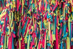 Colourful peaces of clothes be bind together on tree Royalty Free Stock Image