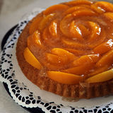 Colourful peach flan or tart Royalty Free Stock Images