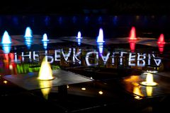Colourful Peak Galleria fountains lit at night Royalty Free Stock Image