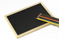 Colourful pencils and black board. Back to school, back to work Royalty Free Stock Photography