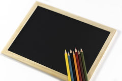 Colourful pencils and clipboard. Back to school, back to work Royalty Free Stock Photography