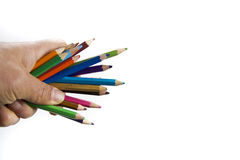 Colourful pencils in hand isolated Stock Images