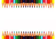 Colourful pencils isolated on white background, blank space in centre, presentation background Stock Image