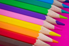 Colourful pencils - school stationery. A shot of some colourful pencils on pink background Royalty Free Stock Photography