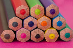 Colourful pencils - school stationery. A shot of some colourful pencils on pink background Stock Photo