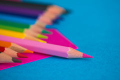 Colourful pencils - school stationery. A shot of some colourful pencils on blue background Stock Photos