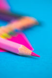 Colourful pencils - school stationery. A shot of some colourful pencils on pink background royalty free stock photos