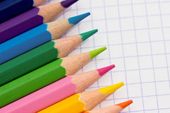 Colourful pencils - school stationery. A shot of some colourful pencils on paper background Royalty Free Stock Photography