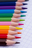 Colourful pencils - school stationery. A shot of some colourful pencils on a piece of paper royalty free stock images