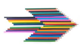 Colourful pencils in shape of arrow Stock Photo