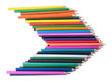 Colourful pencils in shape of arrow stock images