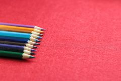 Colourful pensil with red background Stock Photos