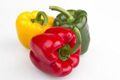 Colourful peppers white background. Colourful fresh isolated peppers on white background stock photos