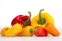Colourful peppers white background. Colourful fresh isolated peppers on white background Stock Photo