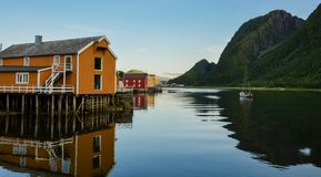 Colourful picturesque wooden houses in Sjogata, Mosjoen, Nordland, Northern Norway. Buildings on the fjord Royalty Free Stock Image