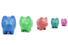 Colourful Piggy banks in a row Royalty Free Stock Photos