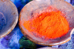 Colourful pigment powders in clay pots Royalty Free Stock Image
